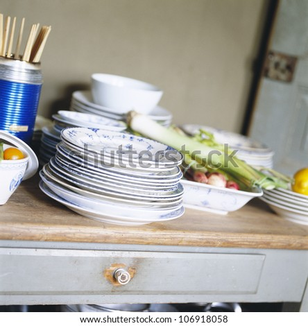 Plates and food in a kitchen. - stock photo