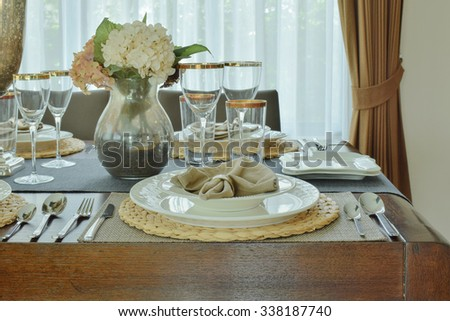 Plates and napkin setting on dining table