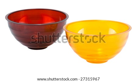 Plates for fruit and salad on white background