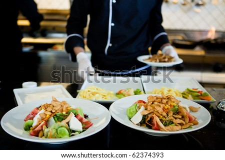 Plates of colorful salad ready to serve