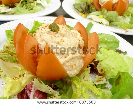 Plates of stuffed tomato with tuna fish