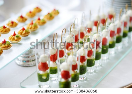 Plates with assorted finger food snacks on an event party or dinner - stock photo