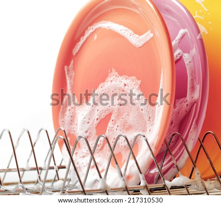 Plates with cleaning foam in dishwasher. - stock photo