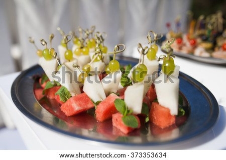 plates with fruits - stock photo