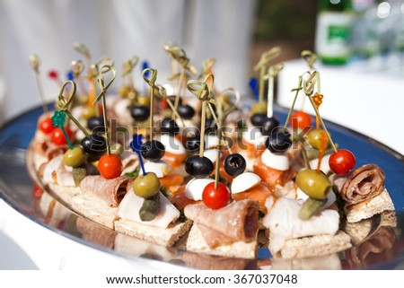 plates with meat dish on some festive event - stock photo