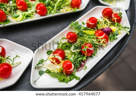 Plates with vegetable mix, food snacks on an event party, wedding, birthday or dinner