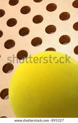 platform tennis paddle and sponge ball detail - stock photo