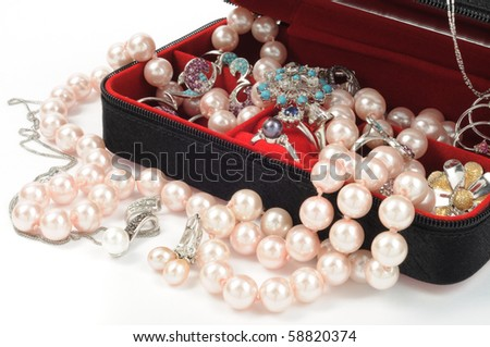 Platinum and pearl jewelry in open box, close up