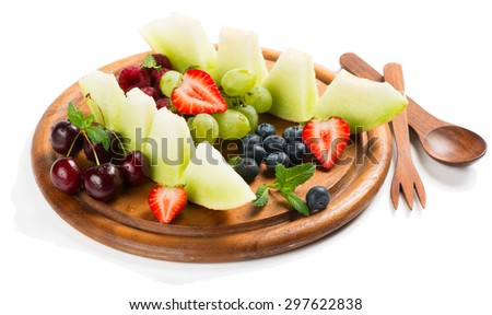Platter of a assorted fresh fruits and berries  isolated on white background