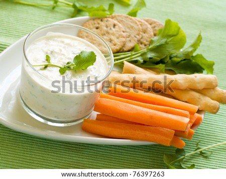 Platter of assorted fresh vegetables and cookies with dip