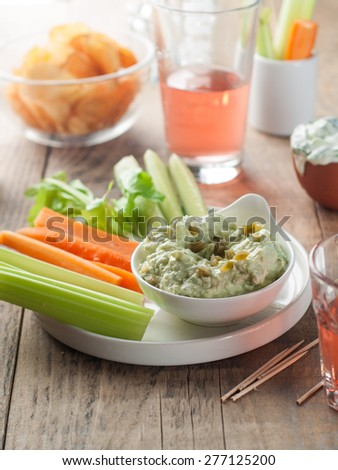 Platter of assorted fresh vegetables with dip, selective focus