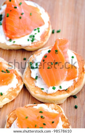 Platter of bite size smoked salmon appetisers suitable for a party - stock photo