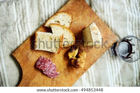 platter of cheese salami and red wine