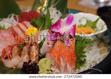 platter of fresh sashimi - stock photo
