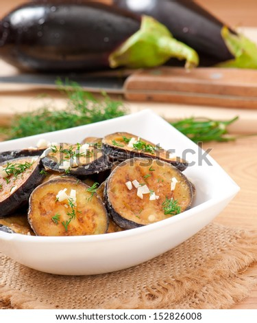 Platter of grilled eggplant with garlic and dill - stock photo