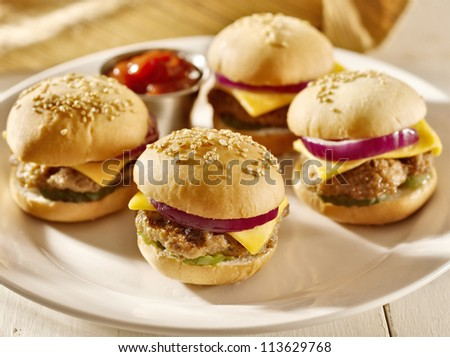 platter of mini burger sliders with ketchup, - stock photo