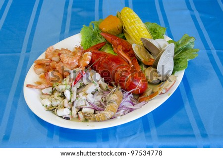 Platter with Cebiche and a selection of seafood. - stock photo