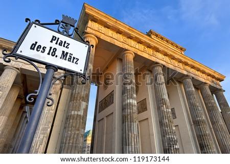 Platz des 18 Marz sign and Brandeburg Gate, Berlin, Germany - stock photo