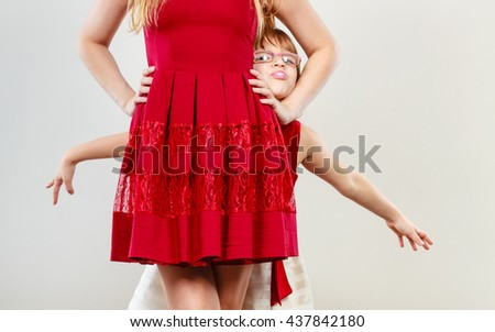 Play and fun. Charming little girl making funny crazy face with mother. Smiling lovely cute female child and woman. Positive facial emotion. - stock photo
