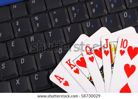 Play cards on a keyboard concepts of online gambling - stock photo