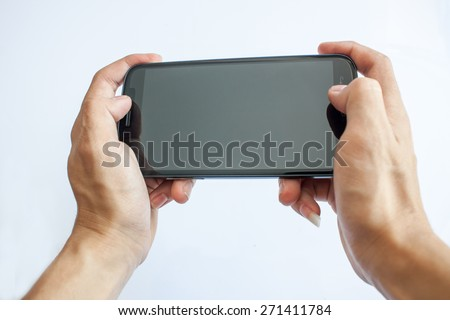 play gamer on smartphone - stock photo