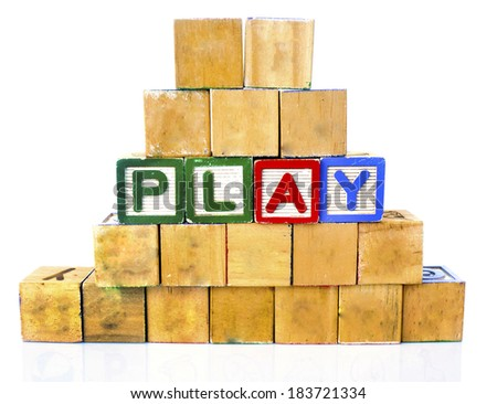 PLAY in alphabet wooden word blocks isolated on a white background                  - stock photo