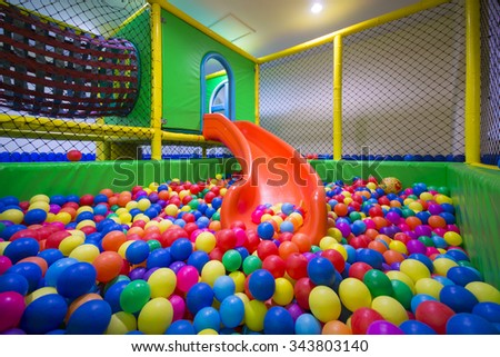 play room with colorful balls at hotel, kid - stock photo