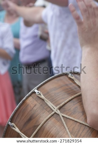 Play the drums. Hands beat the rhythm on the drum. People drum - stock photo