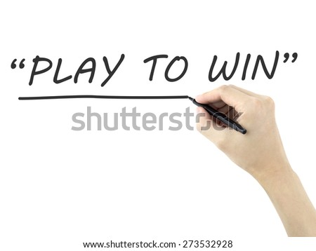 play to win words written by man's hand over white background - stock photo