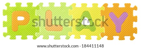 Play word created from Alphabet puzzle isloated on white background , with clipping path. - stock photo