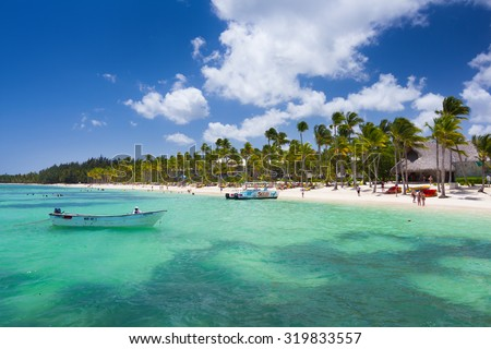 Playa Ba¡varo, Dominican Republic- April 19, 2015: Diving boats moored at the beach with palm trees in the high noon
