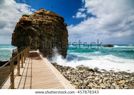 Playa de Roque de Las Bodegas with giant rock, Tenerife, Spain