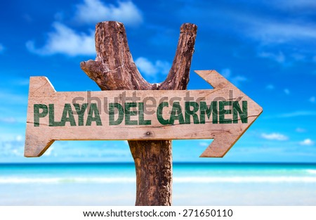 Playa Del Carmen wooden sign with beach background - stock photo