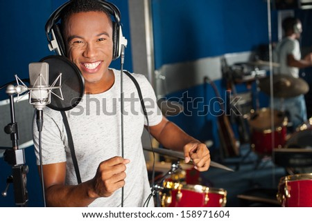 Playback singer recording a track in studio - stock photo