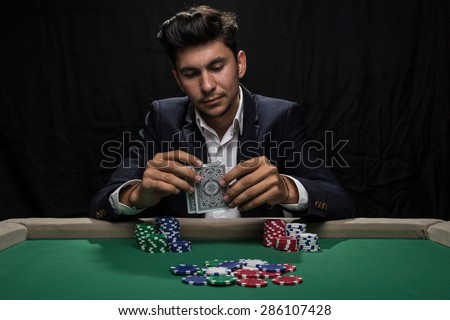 Player at the Poker table. - stock photo