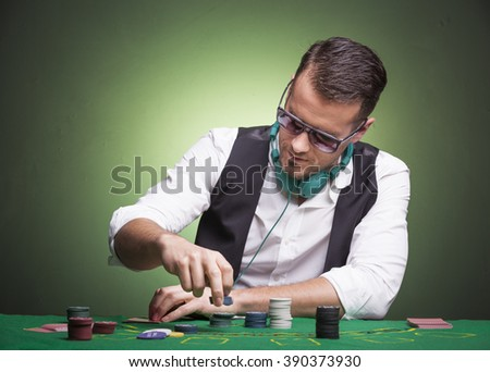 Player at the poker table - stock photo