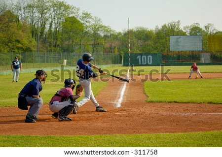 Player hitting ball - stock photo