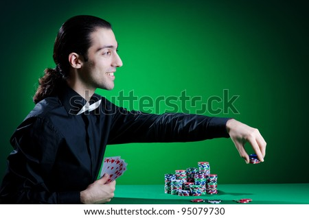 Player in casino and chips - stock photo