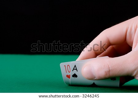 Player's hand revealing Blackjack