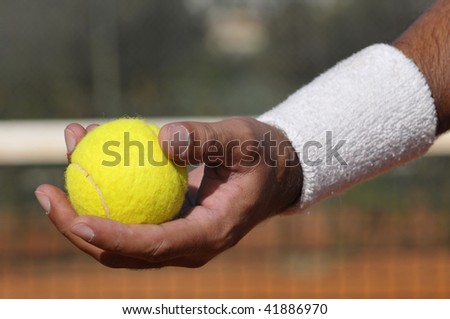 Player's hand with tennis ball in closeup