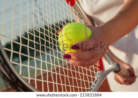 Player's Hands With Tennis Racket And Tennis Ball. Ready To Serve
