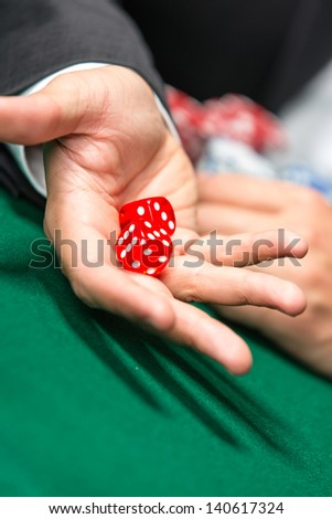 Player throws dices on the poker table. Challenge to the casino - stock photo
