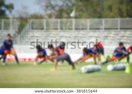 Players in action playing football,Stretching (soccer) - stock photo