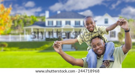 Playful African American Father and Son In Front Yard of Home. - stock photo