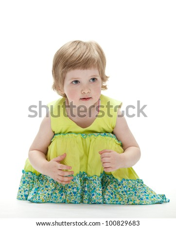 Playful baby sitting on the floor; white background