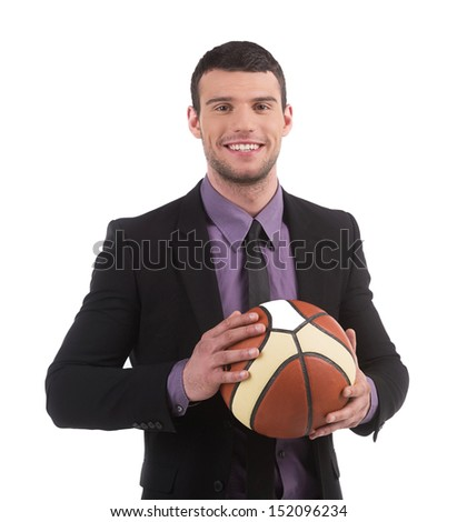 Playful businessman. Confident young man in formalwear holding basketball ball and smiling while isolated on white - stock photo