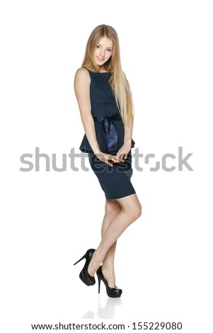 Playful carefree businesswoman in full length against white background