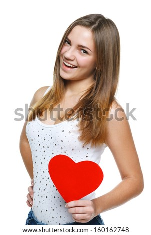 Playful casual teen girl with red paper heart shape with copy space, over white background