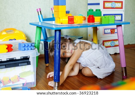 Playful child in her nursery at home