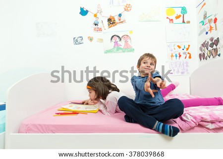 Playful children having fun in their playroom